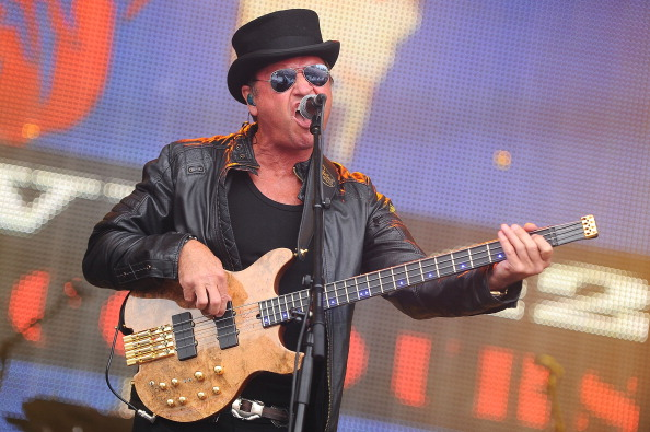 PERTH, SCOTLAND - JULY 28: Mark King of Level 42 performs on stage on Day 3 of Rewind 80s Festival 2013 at Scone Palace on July 28, 2013 in Perth, Scotland.  (Photo by Scott Campbell/Redferns via Getty Images)